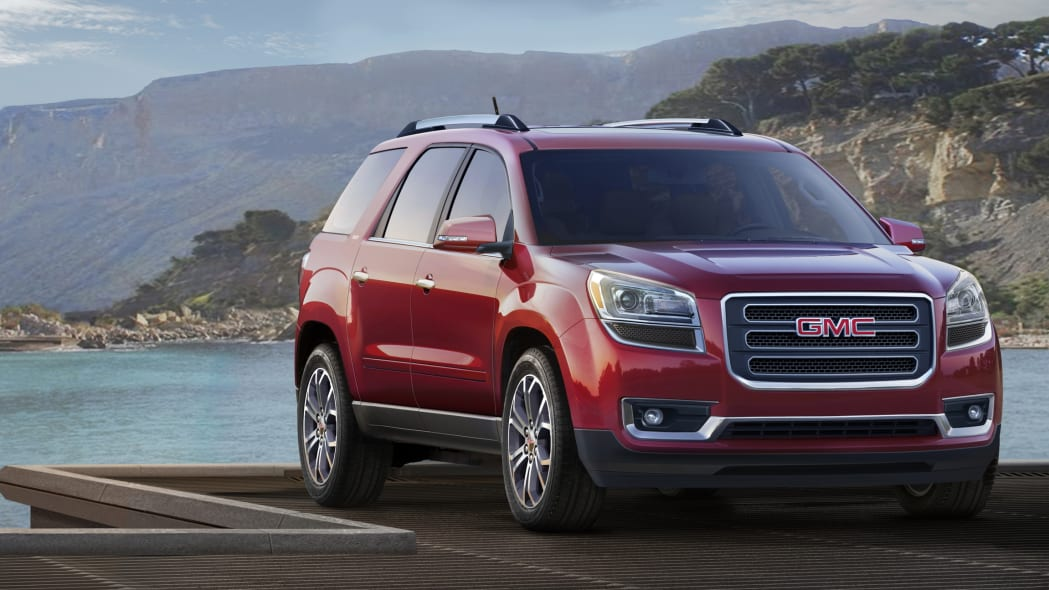 2015 GMC Acadia in red by the ocean
