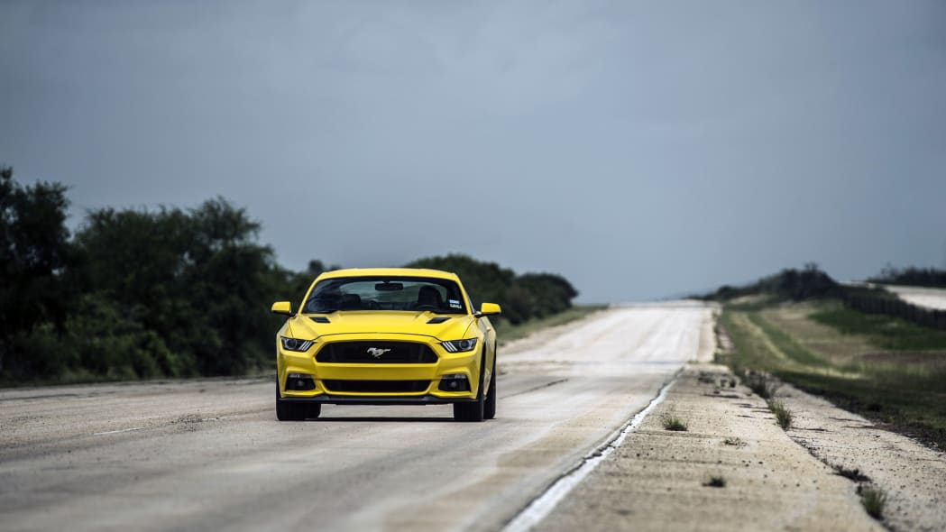 yellow hennessey performance hpe750 mustang on the road