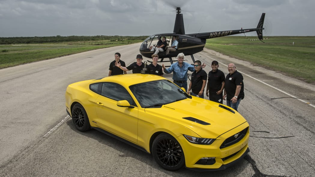 yellow hennessey performance hpe750 mustang with helicopter
