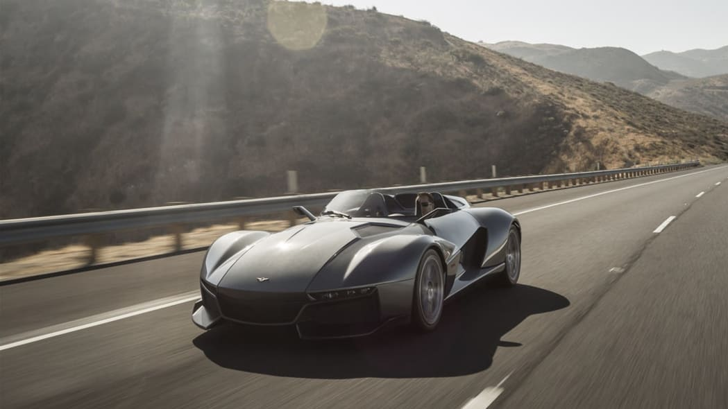 gray rezvani motors beast on the road in shadow