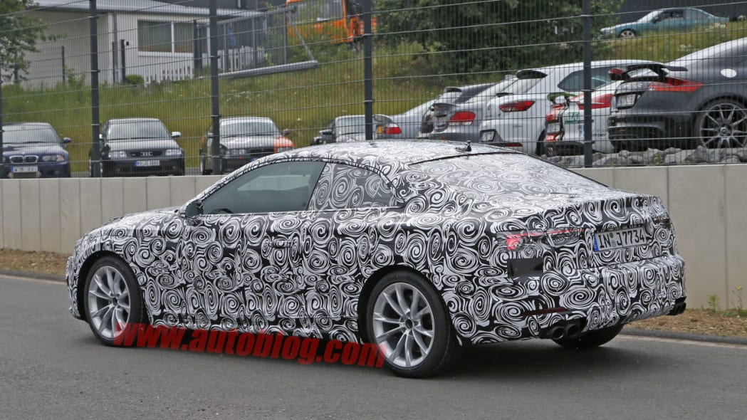 camouflaged audi s5 spy shot rear three quarters