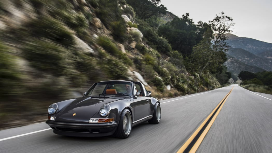 porsche 911 targa 4.0 restored by singer front driving mountain road