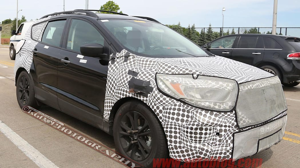 camouflaged black ford escape spy shots grille and headlights