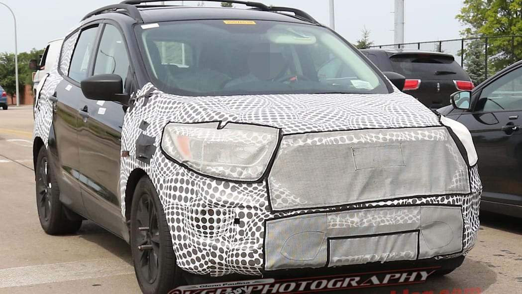 camouflaged black ford escape spy shots changes
