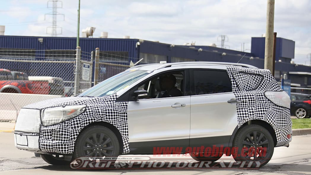 camouflaged silver ford escape spy shots profile
