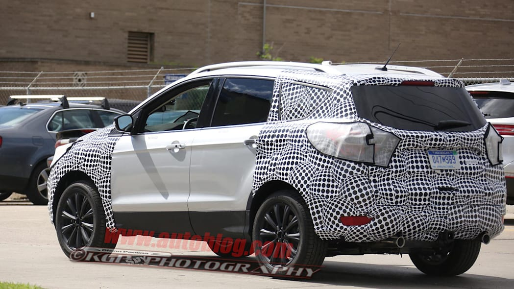 camouflaged silver ford escape spy shots rear three quarters