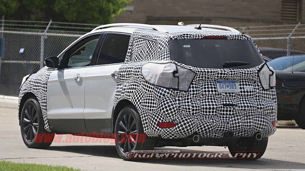 camouflaged silver ford escape spy shots tweaks