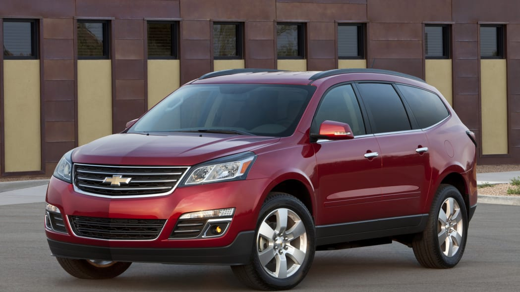 red 2015 chevrolet traverse front three quarters in front of building