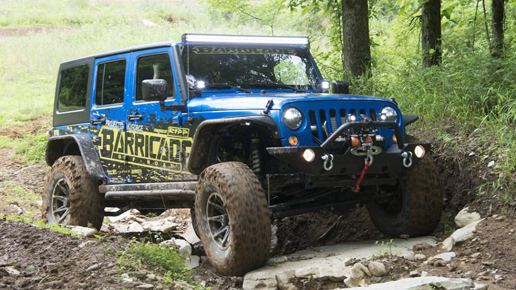 Project Trail Force 2015 Jeep Wrangler Rubicon navigating a trail.