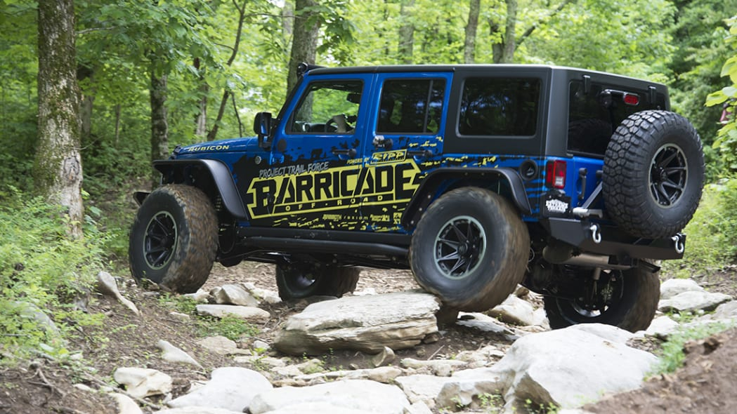 Project Trail Force 2015 Jeep Wrangler Rubicon traversing rocks.