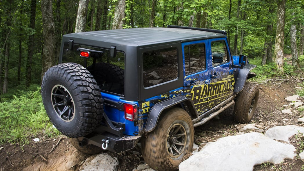 Project Trail Force 2015 Jeep Wrangler Rubicon climbing a trail.