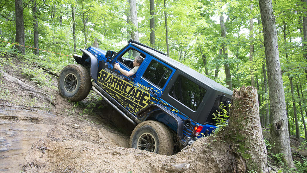 Project Trail Force 2015 Jeep Wrangler Rubicon getting up a hill.