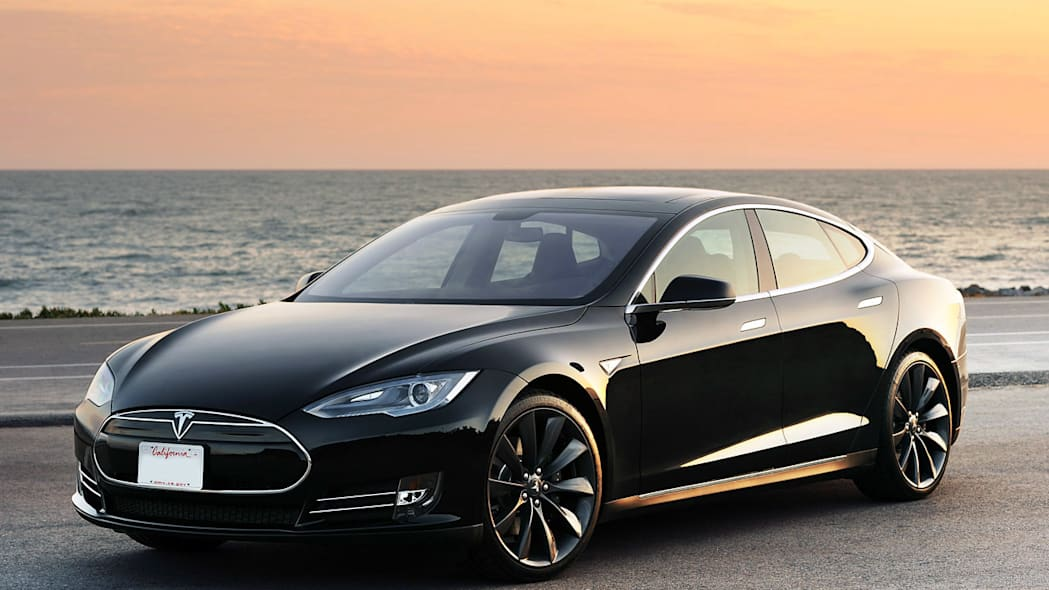 2012 tesla model s front view black ocean sunset