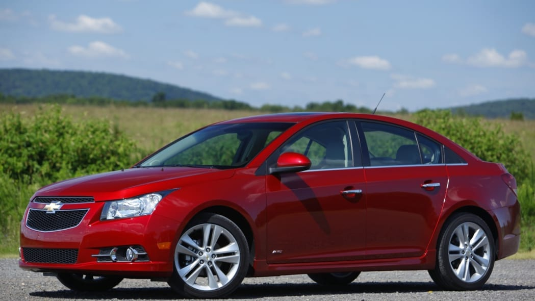 2011 Chevy Cruze red front view corn field