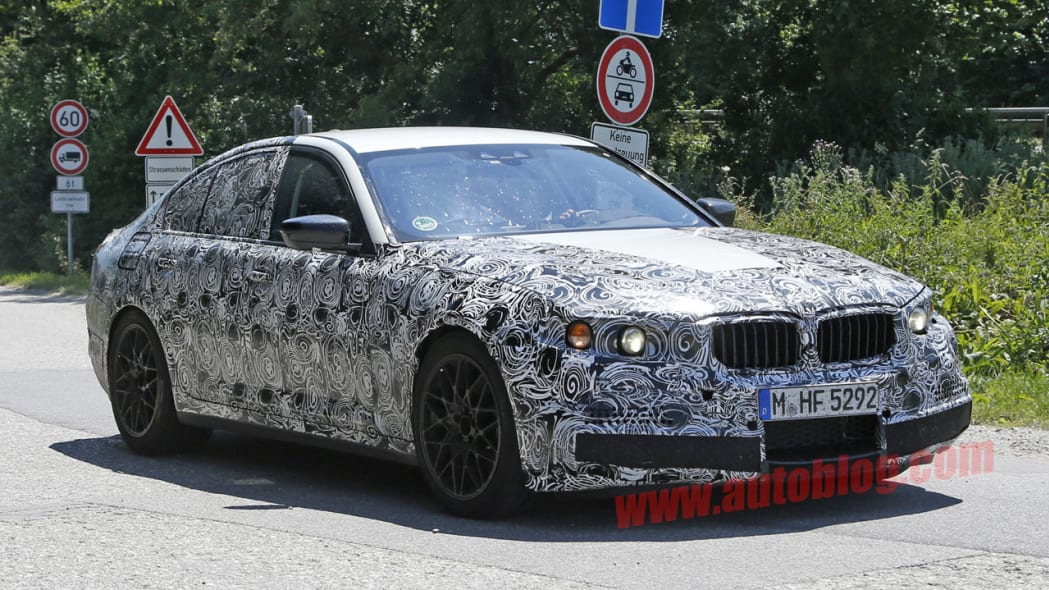 camouflaged bmw m5 spy shots front three quarters
