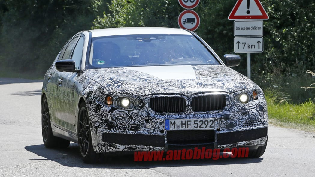 camouflaged bmw m5 spy shots front