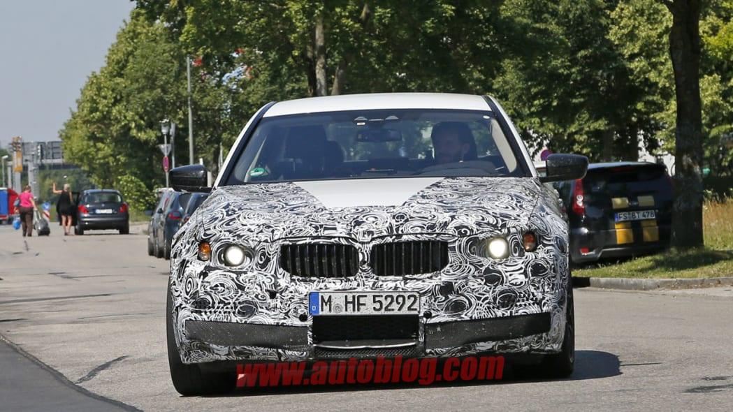 camouflaged bmw m5 spy shots front on