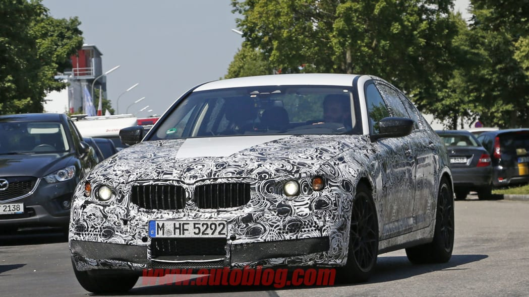 camouflaged bmw m5 spy shots grille
