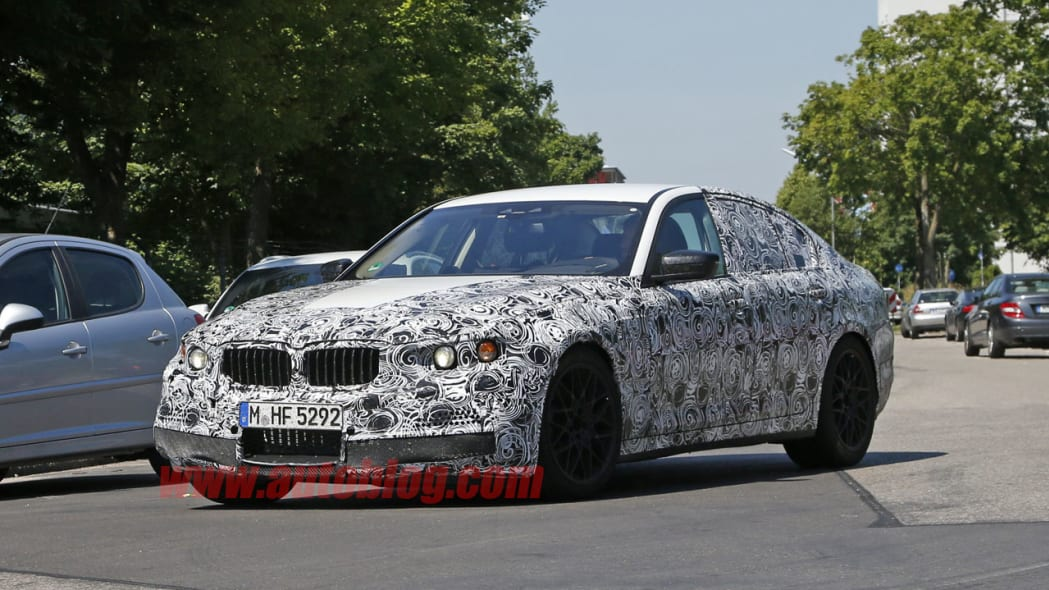 camouflaged bmw m5 spy shots low angle three quarters