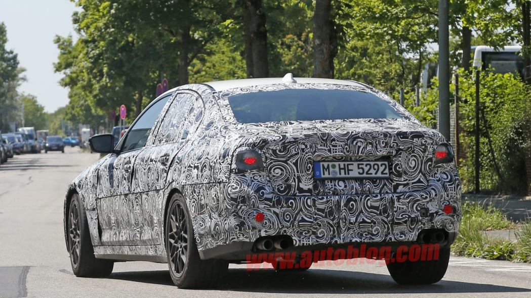 camouflaged bmw m5 spy shots taillights