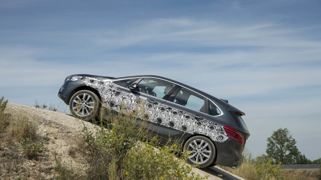 gray bmw 2 series active tourer plug-in hybrid prototype over hill
