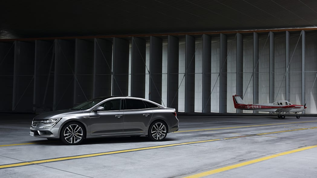 renault talisman sedan airplane hangar airport