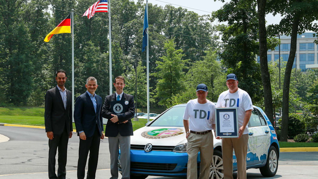 VW executives with record-setting team and 2015 VW Golf TDI
