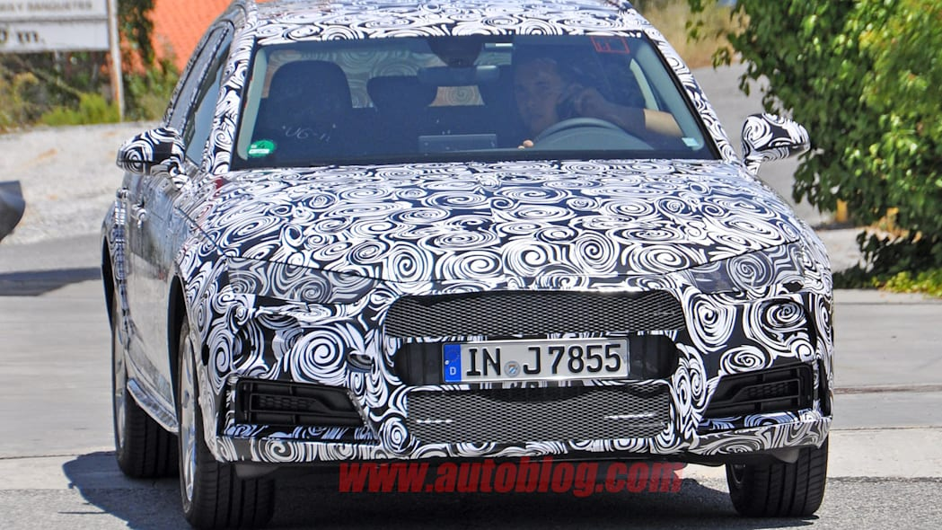 camouflaged audi a4 allroad spy shots front