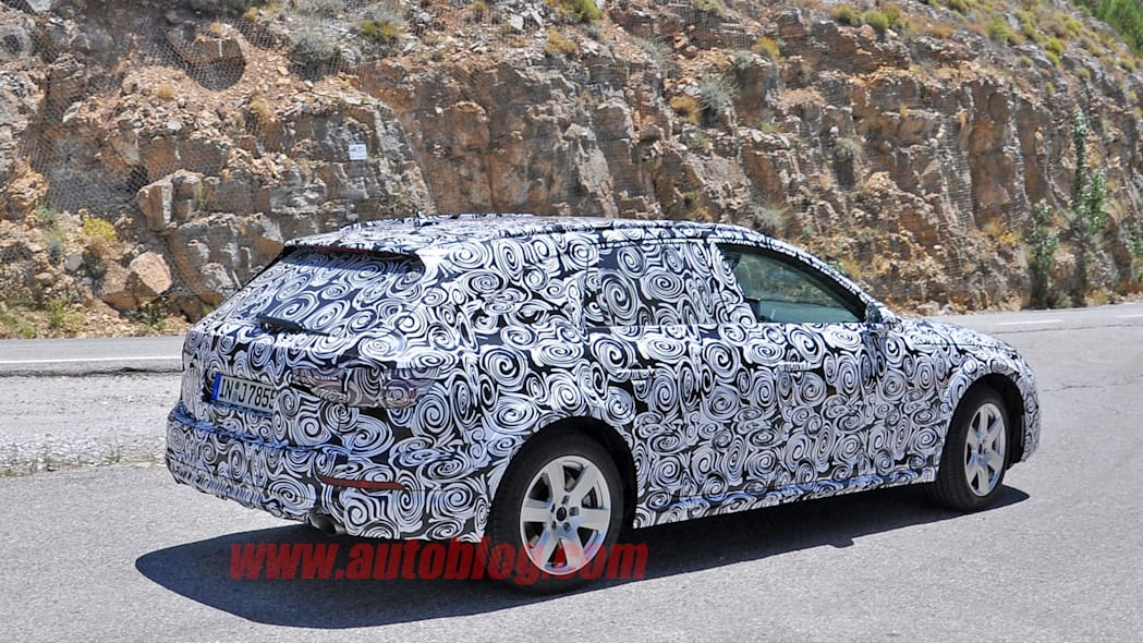 camouflaged audi a4 allroad spy shots rear three quarters