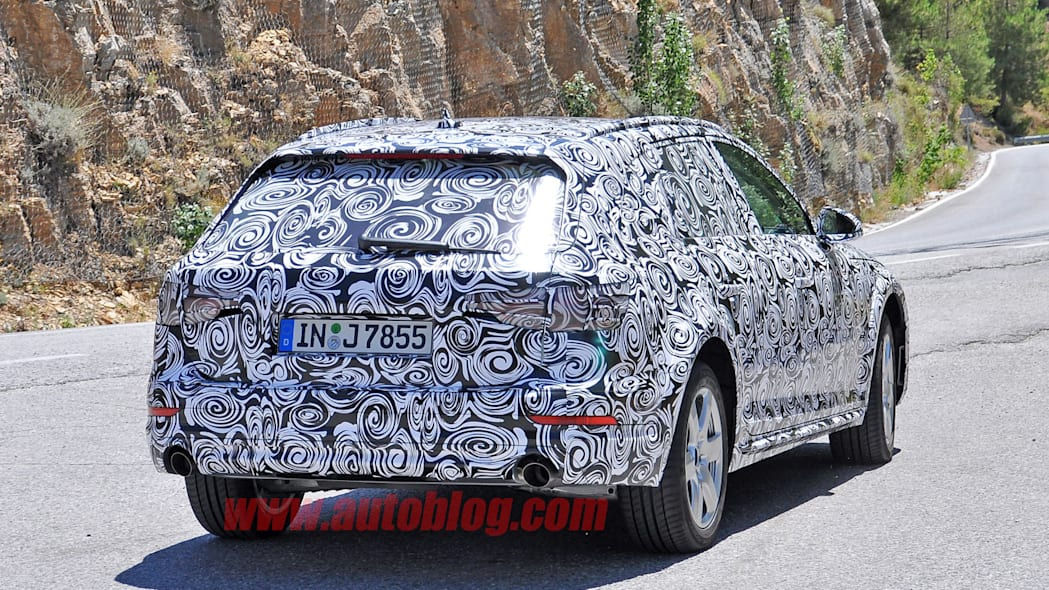 camouflaged audi a4 allroad spy shots rear