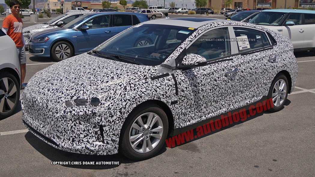 camouflaged hyundai prius-fighter spy shot headlights detail