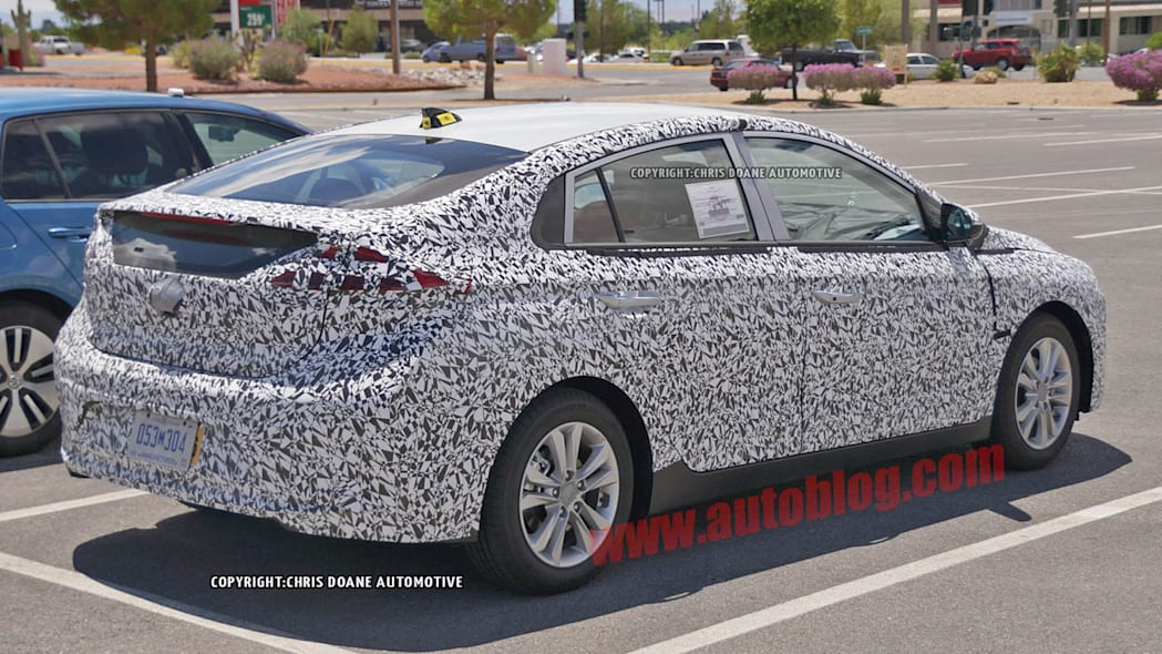 camouflaged hyundai prius-fighter spy shot rear three quarters