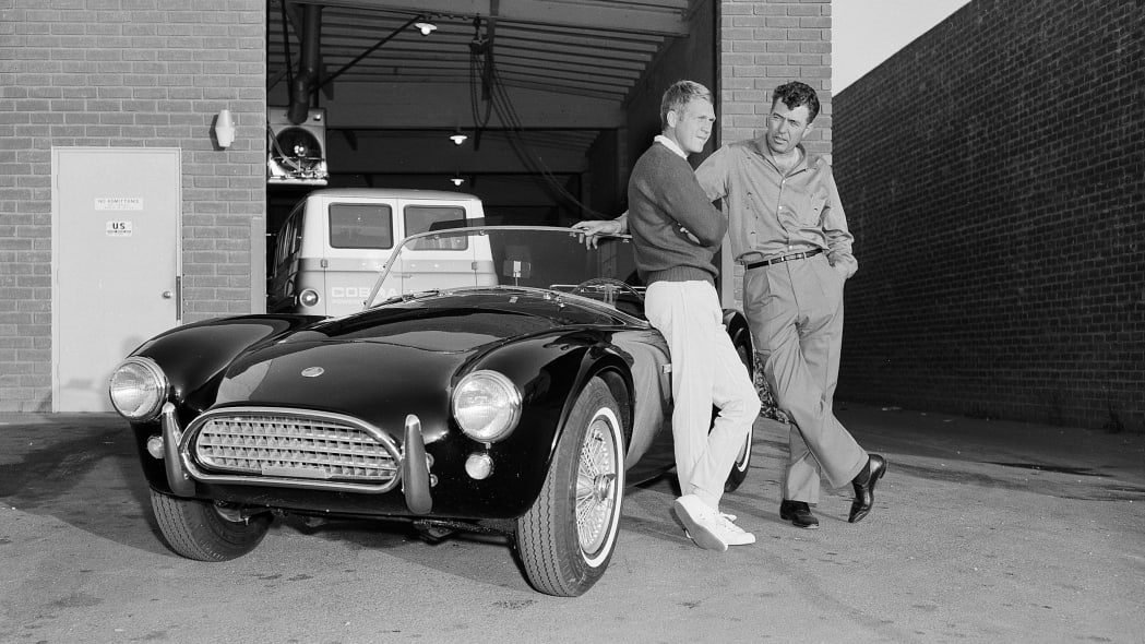 Steve McQueen and Carroll Shelby with a Cobra roadster