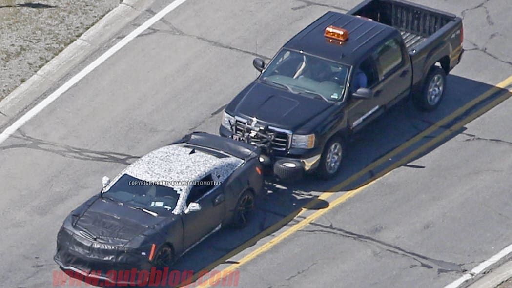 camouflaged chevy camaro zl1 spy shots from above front