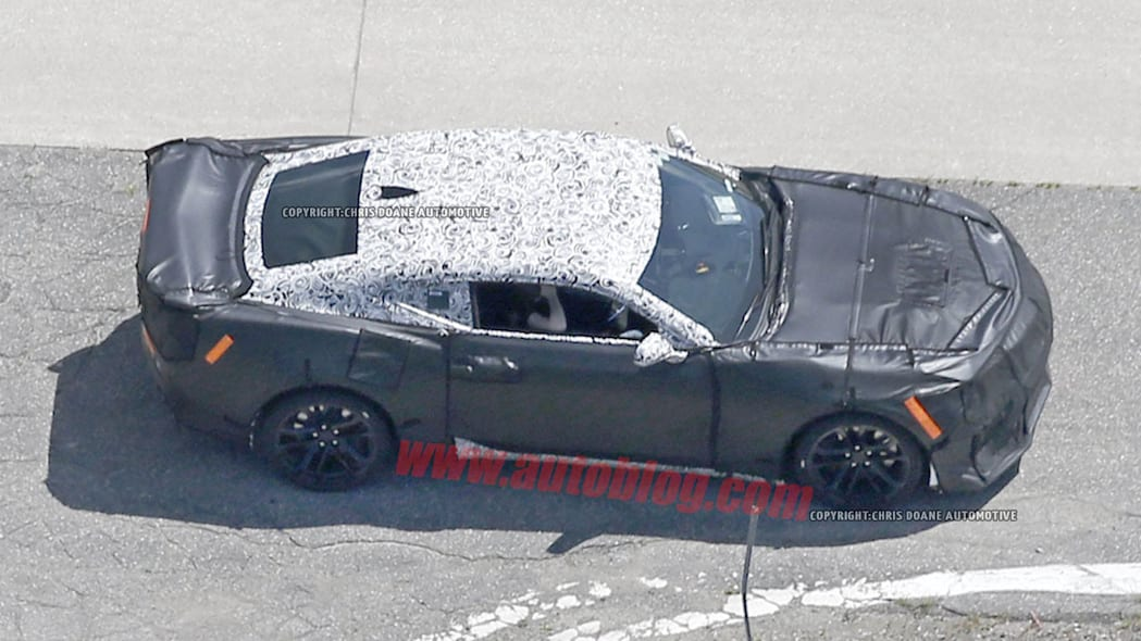 camouflaged chevy camaro zl1 spy shots fenders and wing