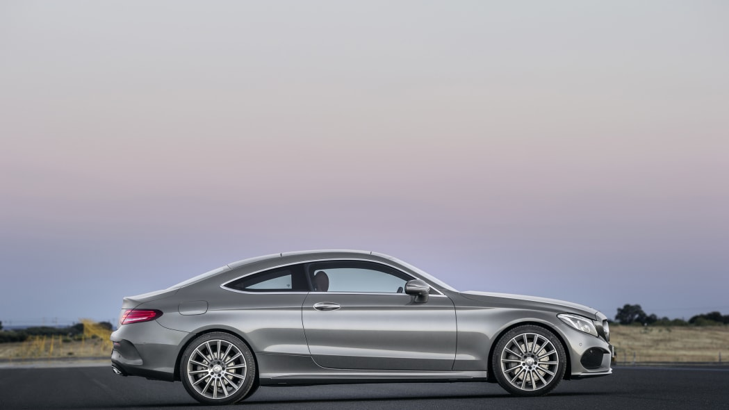 The 2016 Mercedes C-Class Coupe, side view in silver.