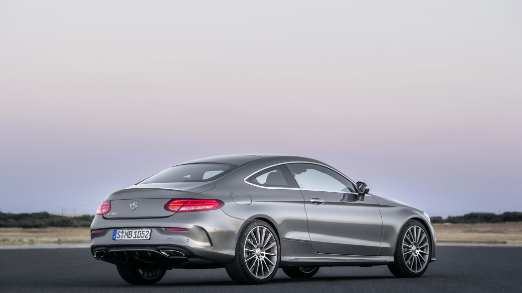 The 2016 Mercedes C-Class Coupe, rear three-quarter in silver.