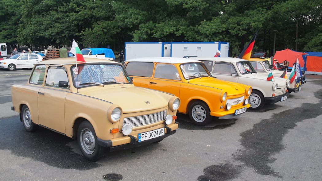 Trabis lined up with flags at the 2015 Trabant Fest in Zwickau, Germany.