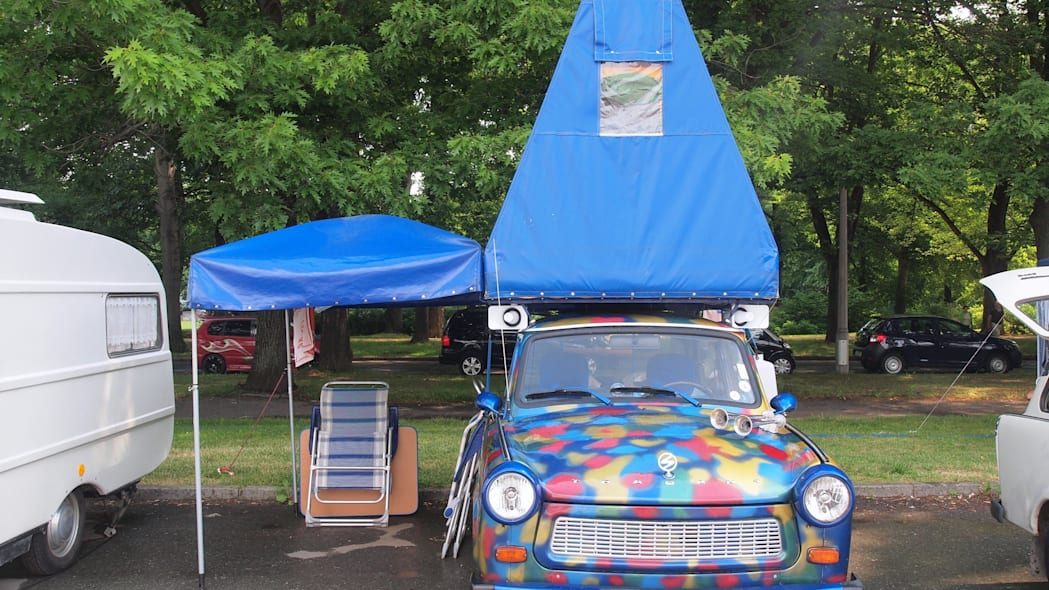 A rainbow Trabi with a blue tent on top at the 2015 Trabant Fest in Zwickau, Germany.