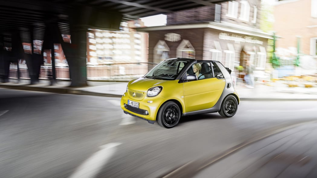 The 2016 Smart Fortwo Cabriolet, front three-quarter dynamic.