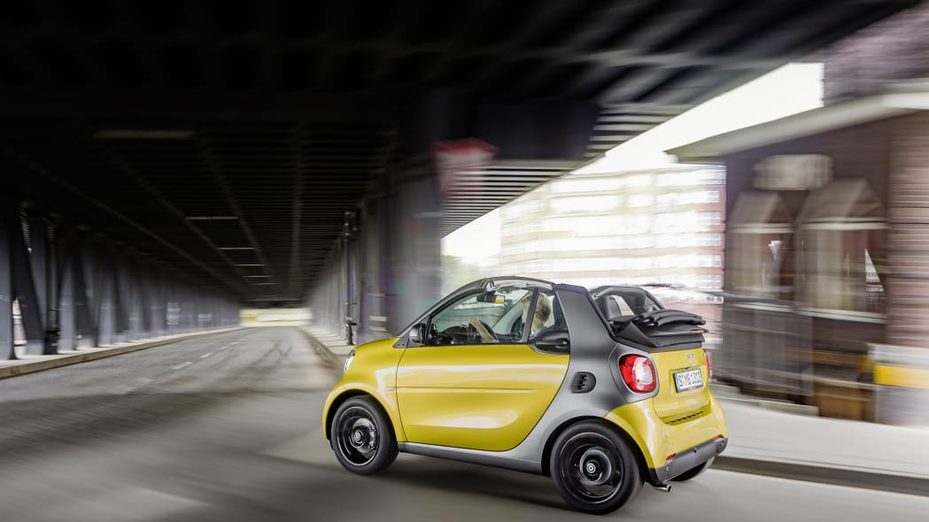 The 2016 Smart Fortwo Cabriolet, rear three-quarter dynamic.