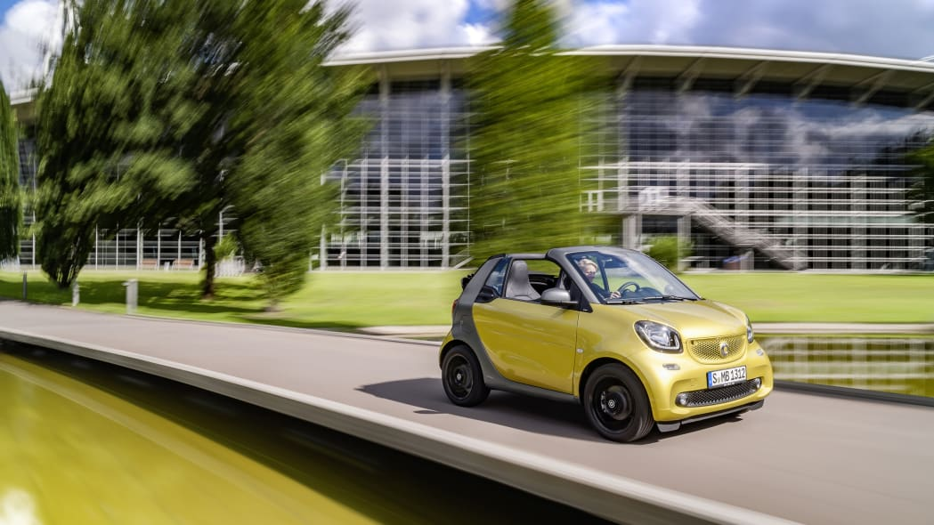The 2016 Smart Fortwo Cabriolet, front three-quarter near park.