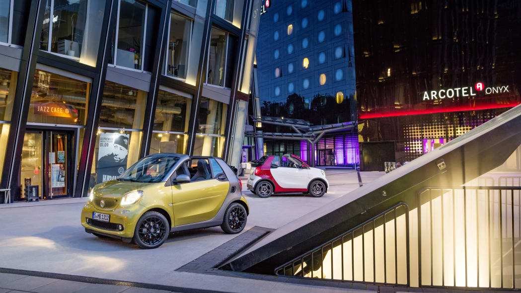 The 2016 Smart Fortwo Cabriolet, front three-quarter static, two models.