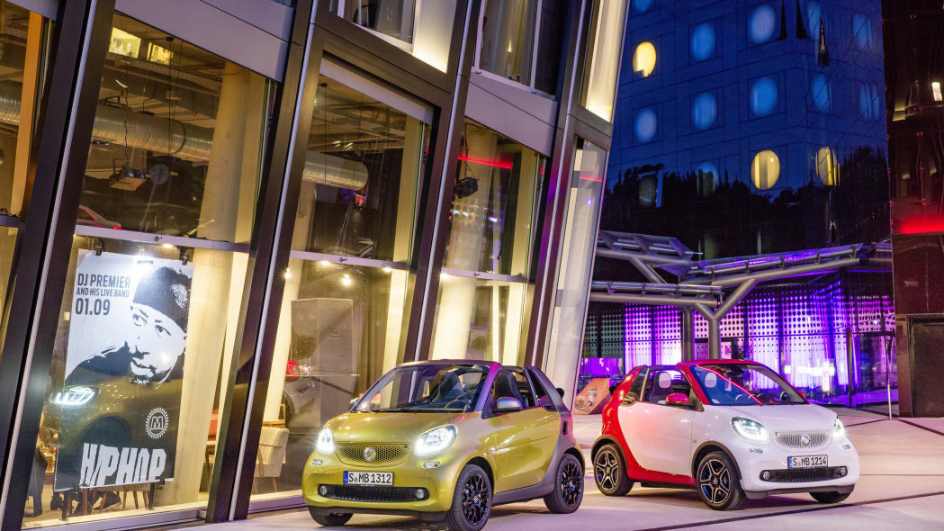 The 2016 Smart Fortwo Cabriolet, front three-quarter, two models, static.