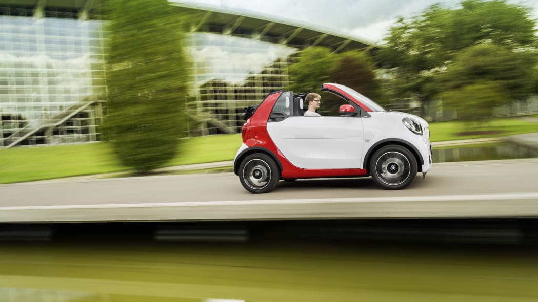 The 2016 Smart Fortwo Cabriolet, pure trim, side view dynamic.