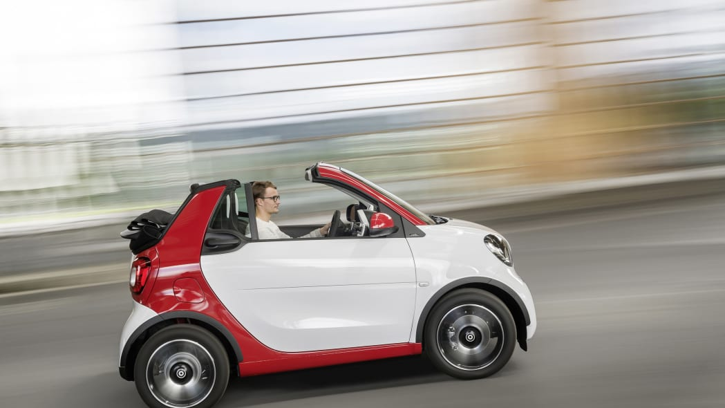 The 2016 Smart Fortwo Cabriolet, pure trim, side view, dynamic.