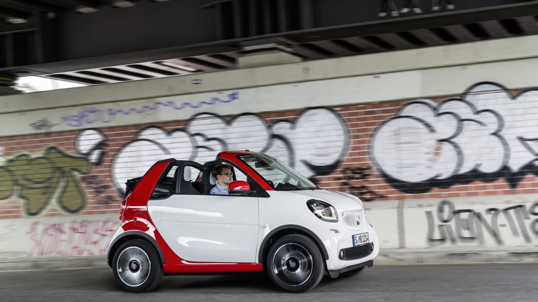 The 2016 Smart Fortwo Cabriolet, pure trim, front three-quarter dynamic.