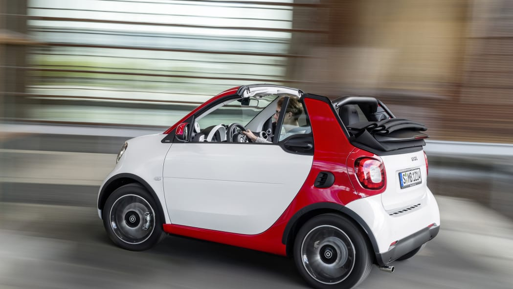 The 2016 Smart Fortwo Cabriolet, passion trim, rear three-quarter turning.