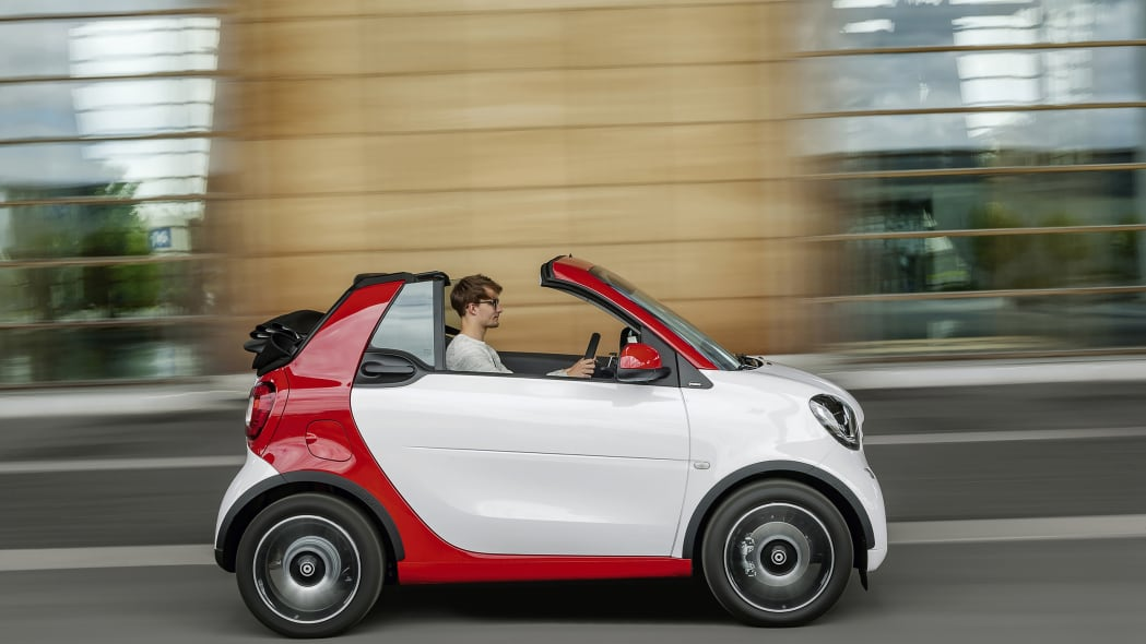 The 2016 Smart Fortwo Cabriolet, passion trim, side view top down.