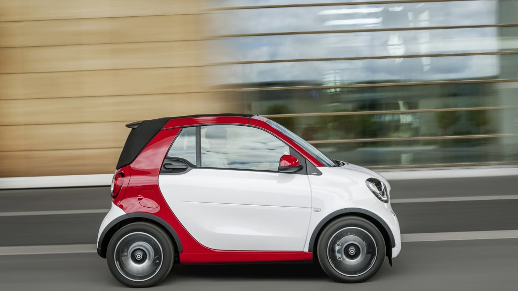 The 2016 Smart Fortwo Cabriolet, passion trim, side view top up.